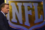 NFL Commissioner Roger Goodell arrives for the Super Bowl 50 press conference February 5, 2016 at the Moscone Convention Center in San Francisco, California. A perfectly scripted duel between Peyton Manning and his heir apparent Cam Newton will captivate America on Sunday as the Super Bowl marks its 50th anniversary with a quarterback showdown for the ages. / AFP / Timothy A. CLARY        (Photo credit should read TIMOTHY A. CLARY/AFP/Getty Images)